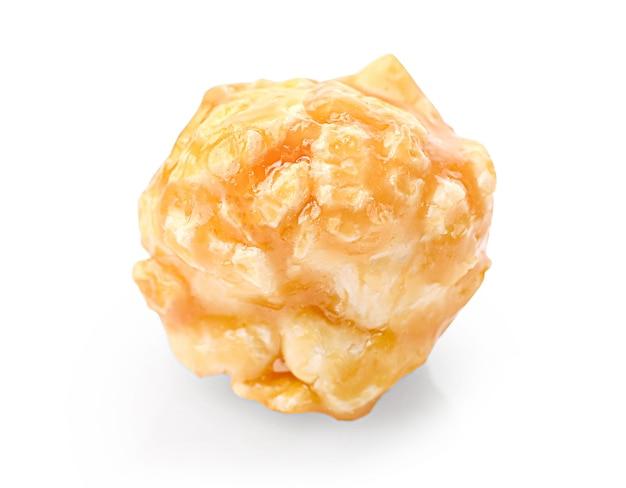 Single sweet caramel popcorn isolated on white.