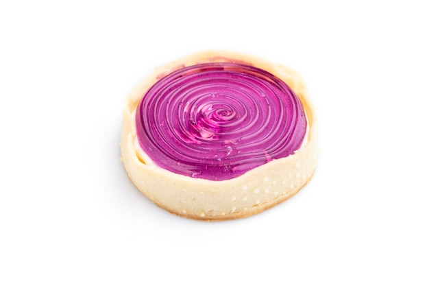 Single sweet tartlet with jelly and milk cream