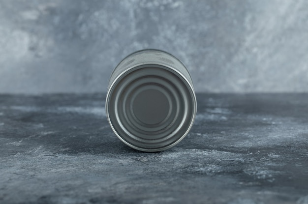 Single tin can placed on marble.