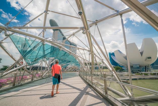 Single tourist on helix bridge in marina bay, singapore