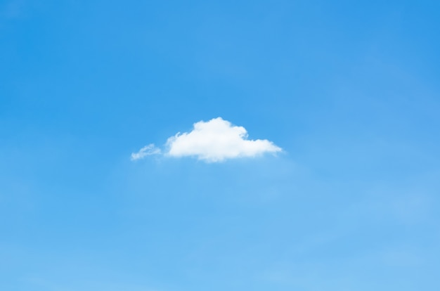 Single white cloud stay alone in bright blue sky in summertime