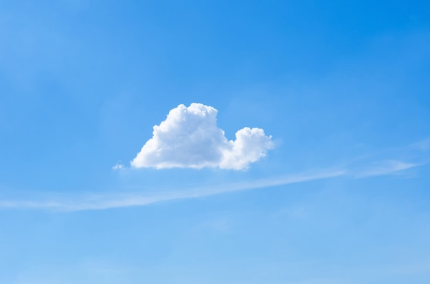 Single white cloud that look like snail in bright blue sky in summertime