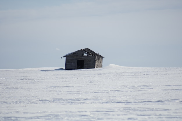 Single wooden cottage in the winter during daytime