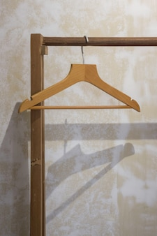 Single wooden hanger on pole