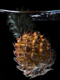 Sinking pineapple close up