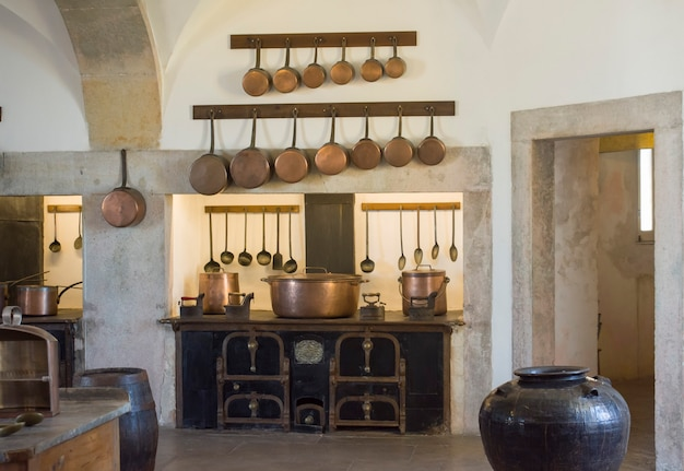 Sintra, palace pena, portugal - august 08, 2017 : copper kitchen utensil on the kitchen of national palace pena, portugal