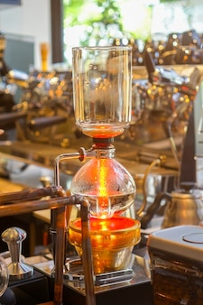 Siphon (syphon) coffee maker is a vacuum coffee maker brews coffee