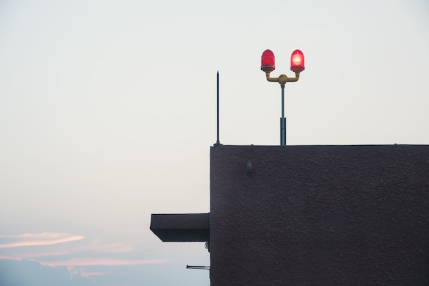 Siren on roof deck tower sky