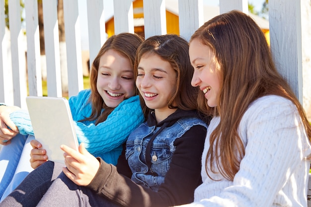 Sister girls friends having fun with technology