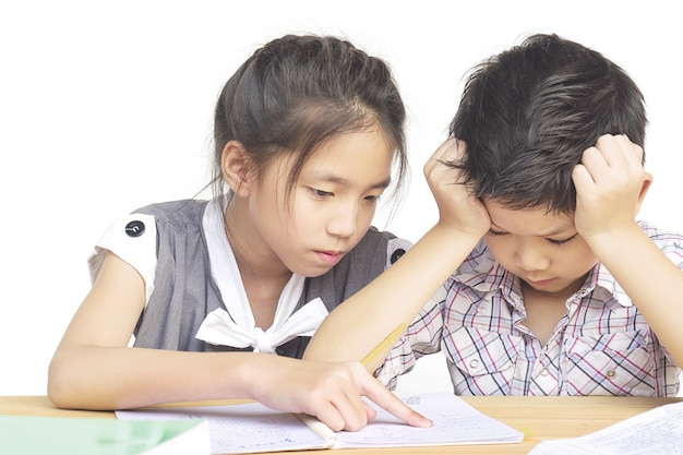 Sister try to teach her naughty younger brother to do homework