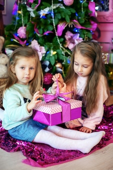Sisters, children holding gifts.