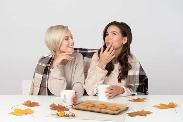 Sisters drinking coffee