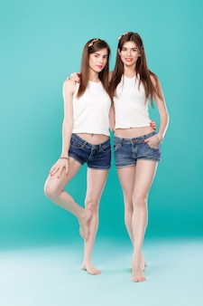 Sisters twins on blue background