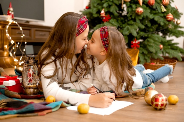 Sisters writing letter to santa claus