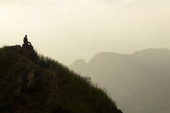 Sit alone on top of mountain