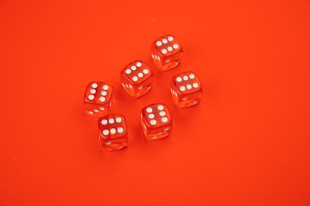 Six game dices isolated on red.