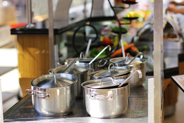 Six saucepans of stainless steel on the stove