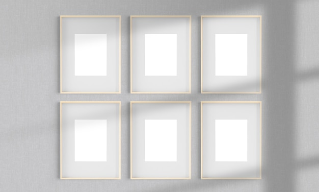 Six wooden frames on a wall mockup 3d rendering