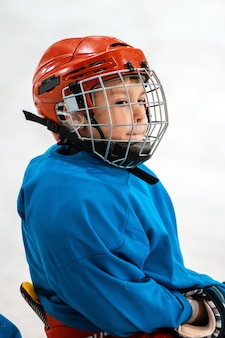 Six year old child hockey player in helmet