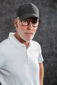 Sixty year old man wearing a baseball cap