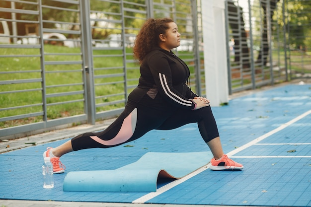 Over the size of a woman doing stretching exercises