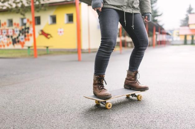 Skateboarder skateboarding on city street
