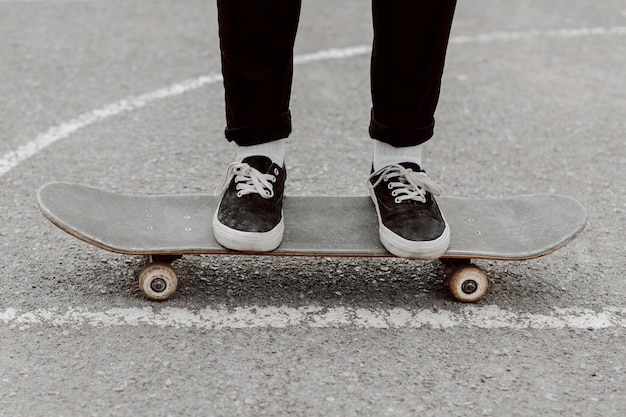 Skater girl legs standing on her skateboard