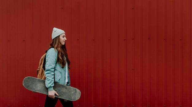 Skater girl in the urban copy space