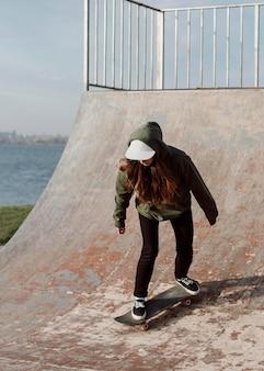 Skater girl using ramps for tricks