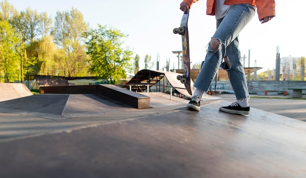Skater holding board close up