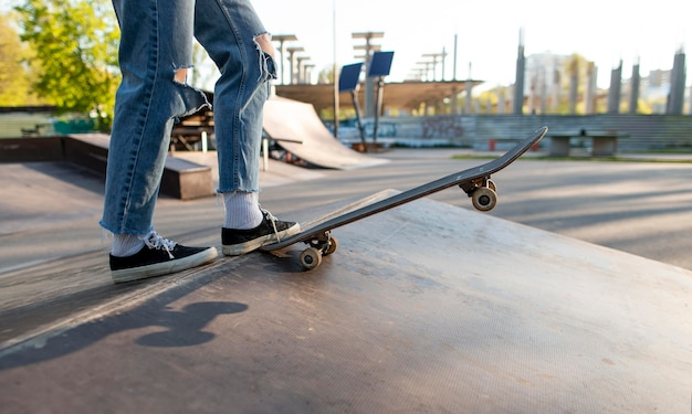 Skater holding board with foot