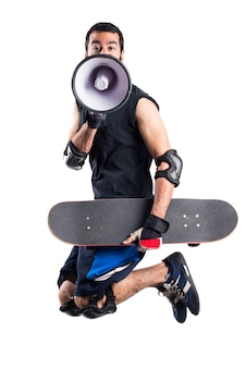Skater jumping and shouting by megaphone