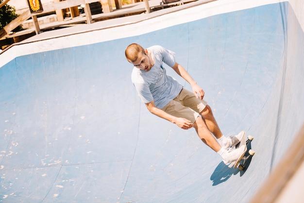 Skater riding on ramp in park