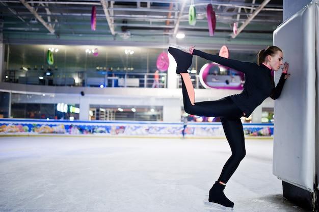 Skater woman at ice skating rink