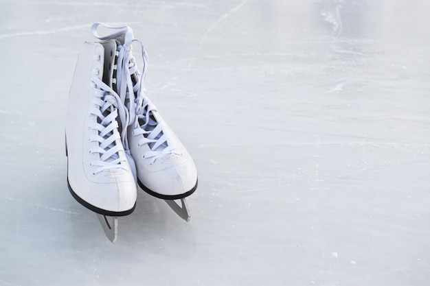 Skates lie on the ice. winter entertainment ice rink.