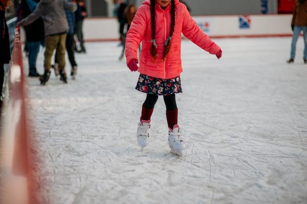 Skating on ice rink