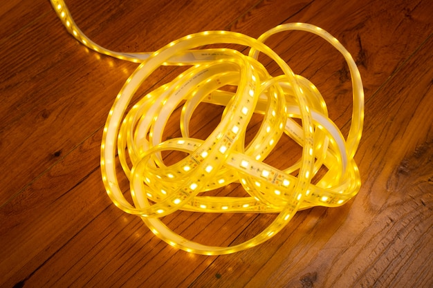 Skein of led strip with warm yellow light close-up.