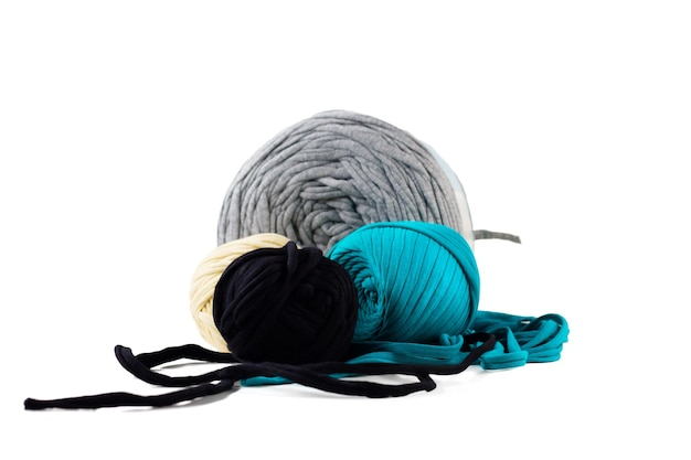 Skeins of turquoise, black, gray, beige knitted yarn