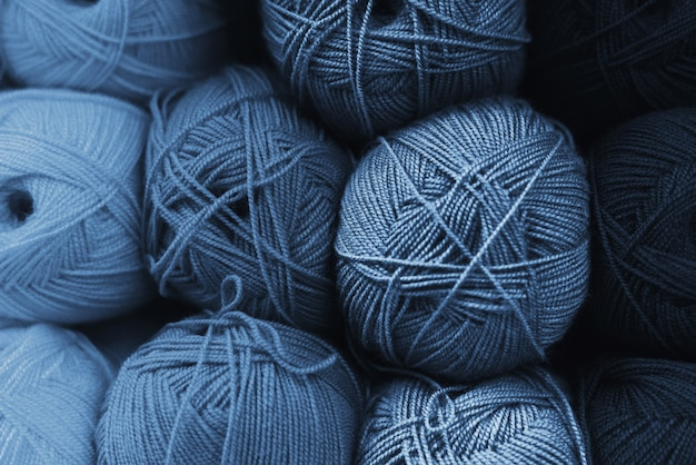 Skeins of wool in all shades of classic blue. handmade concept. the color of the year 2020 is classic blue.