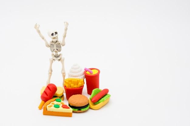 Skeleton and foods, enjoy eating until death with junk foods.