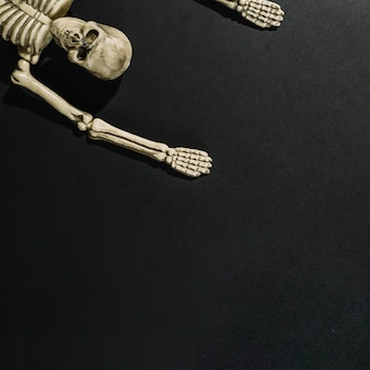 Skeleton lying with hands up