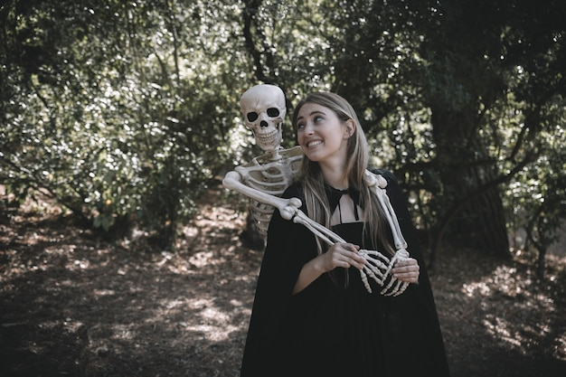 Skeleton standing behind laughing lady