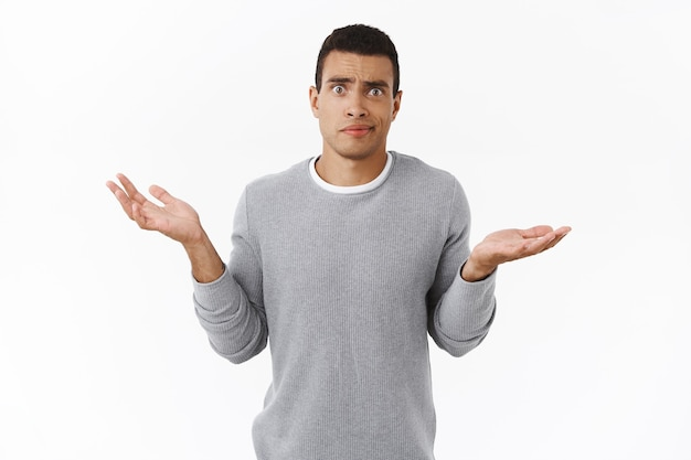 Skeptical and confused, disappointed hispanic guy dont understand anything