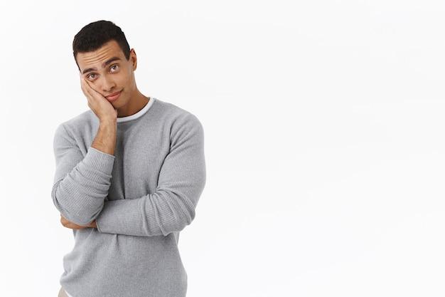 Skeptical hispanic guy smirk, leaning on palm