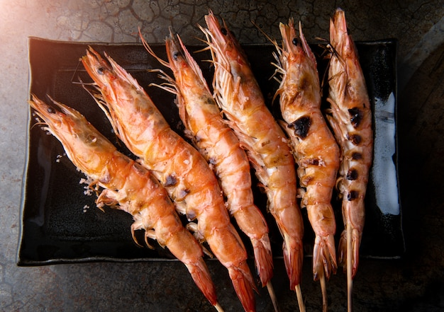 Skewer grilled shrimp prawns.