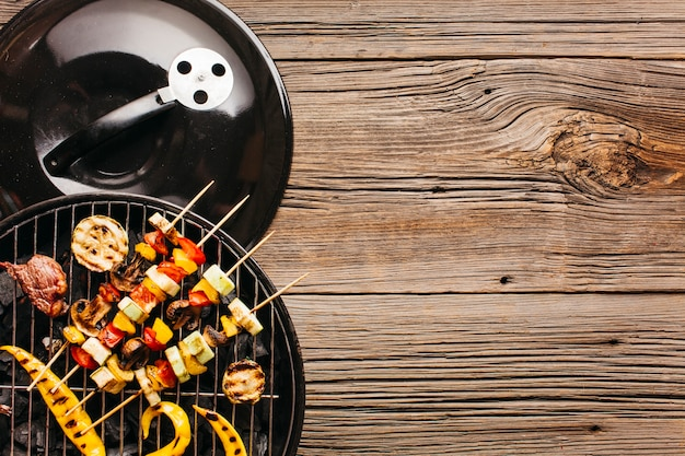 Skewer with fresh meat and vegetable on grill
