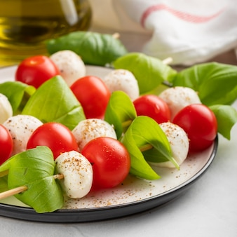 Skewer with tomato, mozzarella and basil.