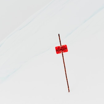 Ski area boundary sign in snow, whistler, british columbia, canada