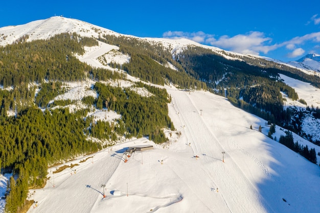 Ski area on the snow-covered mountains of saalbach-hinterglemm in austria