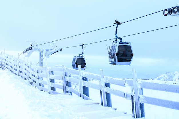 Ski cable cars over mountain landscape on winter day. skiing. winter sport, fun.